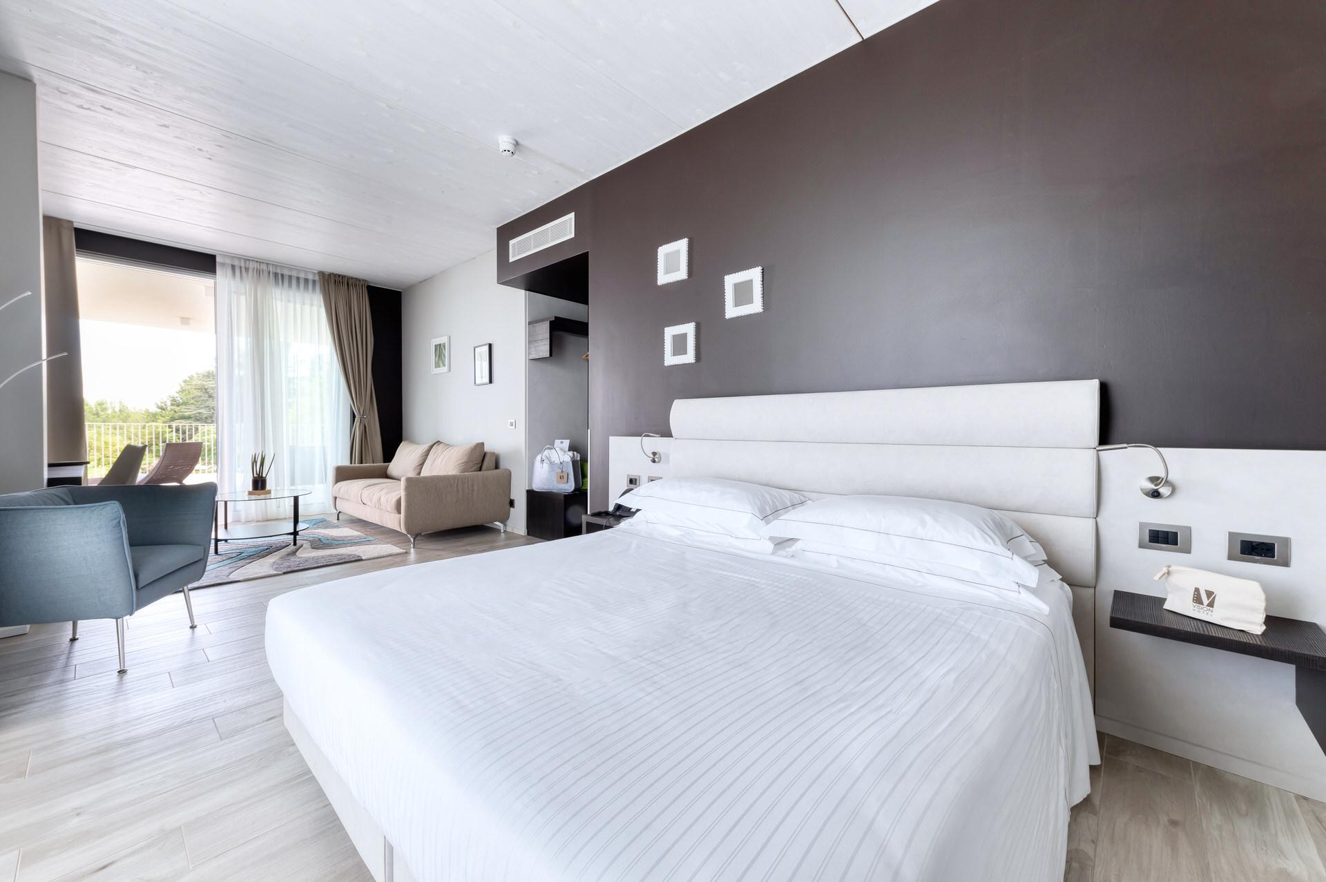 servizio fotografico professionale camera letto hotel lago garda